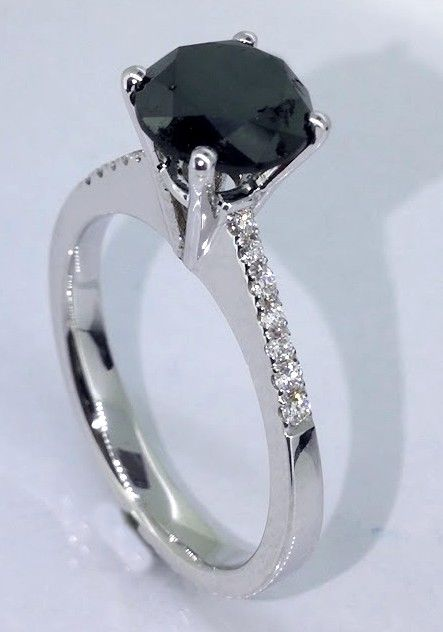 Ring with a black diamond total  1.30 ct - white diamonds 0,10ct  *** No reserveprijs ***