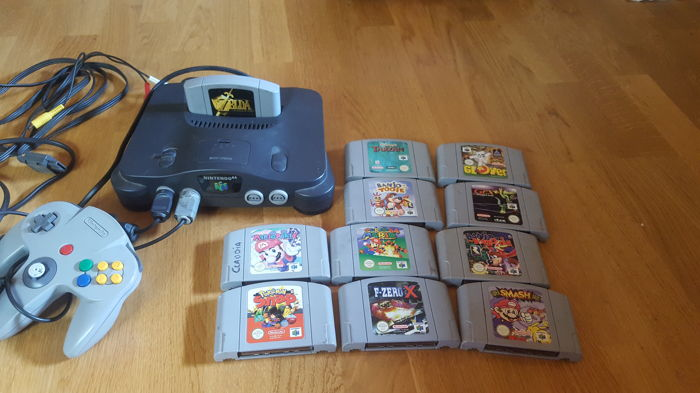 Nintendo 64 console with 2 joysticks and 11 games