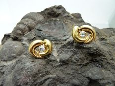 Earrings in 18 kt bicolour gold with zirconias.