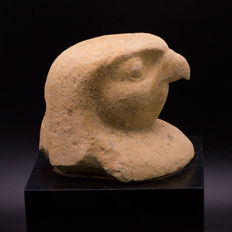An Egyptian limestone canopic lid for Qebehsenuef - 8 cm