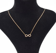 14 carat yellow gold necklace  with entire pendant  , chain length : 45  cm  approx