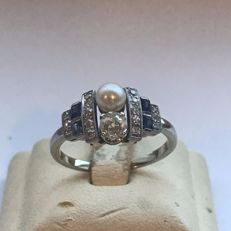 18 kt white gold women's ring with diamonds and sapphires, 0.81 ct in total; ring size: