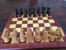 Wooden chess game with hand-carved pieces including board, the board has minimal traces of use.