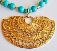 Beautiful , Tumbaga Gold , artifact , Colombian , Tairona Culture ,   A pendant of an indian native chief , pectoral , mounted on a gorgeous , Colombian handcrafted , necklace ,  with natural turquoise balls and gold plated chain