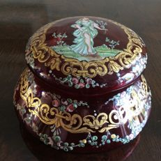 Bohemian cranberry glass box with gold and enamel painting, circa, 1900.