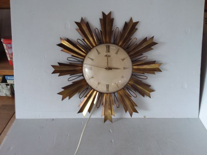 Sun clock Starlux in brass - 20th century