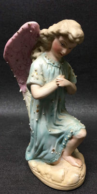 Bisque porcelain kneeling angel 2nd half of 19th century