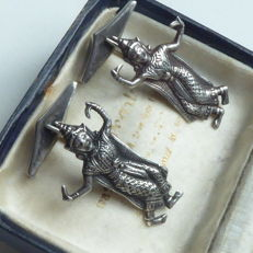 A pair of antique silver cufflinks with dancers from the former Siam.