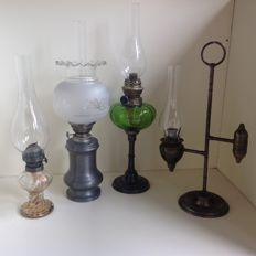 Brocante oil lamps and a candlestick.