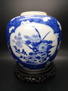 A large antique blue and white plum blossom jar - China - 19th century