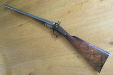 Exempt-antique English shotgun.
