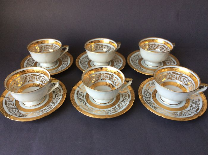 Pil Limoges, twelve piece coffee set, floral gold decorations