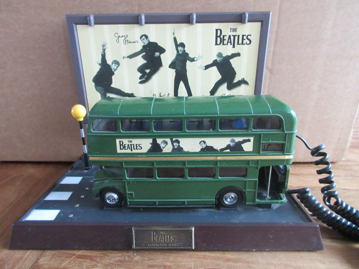 The Beatles-Original Route Master Phone in the Shape of a Green Double Decker bus.