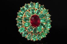 18 kt gold entourage ring set with natural ruby and emeralds, size 56.