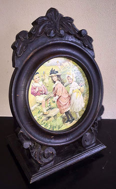 A very beautiful and large wood carved photo frame with print, France, first half 20th century