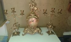 Set of bronze mantle clock and matching candle holders