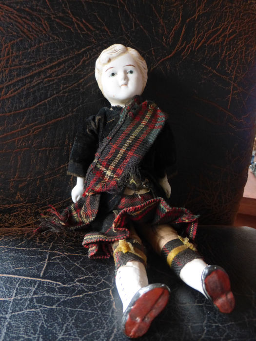 Scot porcelain Brustblatt doll around 1900