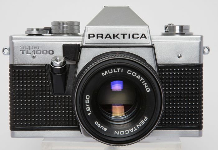 Praktica super tl 1000 with 4 lenses. catawiki