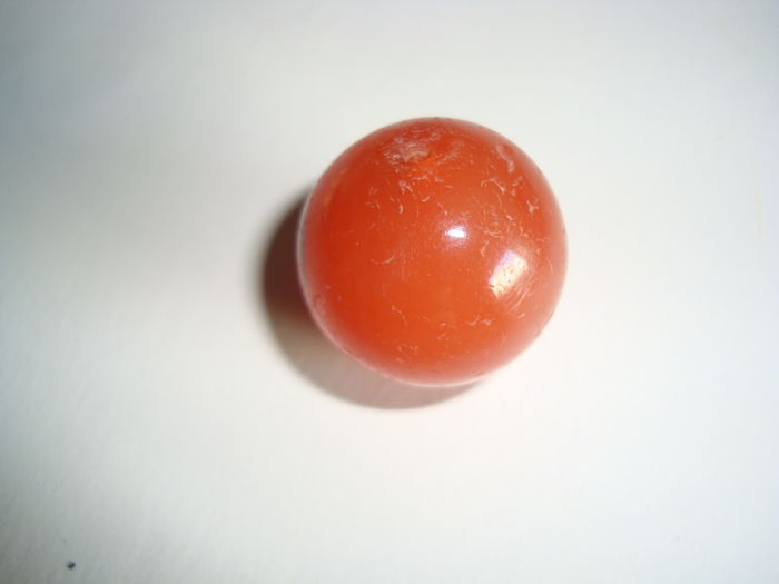 A beautiful,big size carnelian  bead with an agate plaque on one side - 22 mm