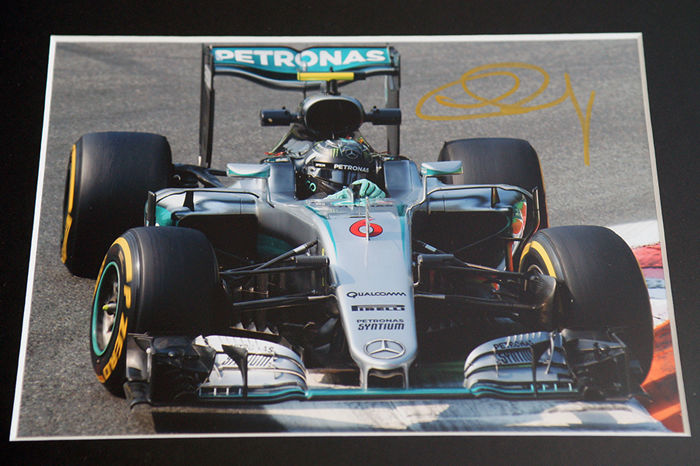 Nice framed image, personally signed by Nico Rosberg