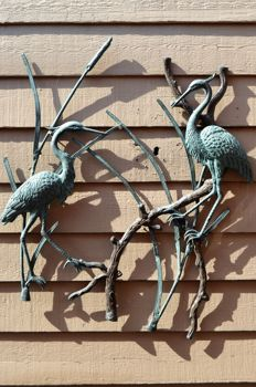 Wall sculpture, two beautiful bronze herons for the wall