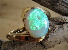 Gold ring with large Australian opal