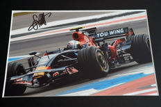 Nice framed image, personally signed by Sebastian Vettel