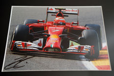 Nice framed image, personally signed by Kimi Raikkonen
