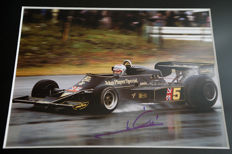 Nice framed image, personally signed by Mario Andretti