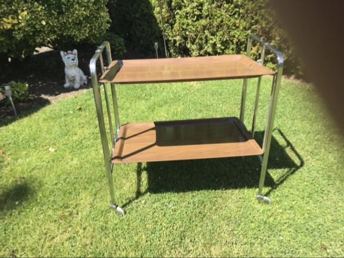 Vintage serving trolley with chrome tubular frame and formica trays, collapsible.
