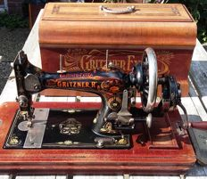 Decorative Gritzner Extra manual sewing machine with matching cover, Germany, ca. 1920