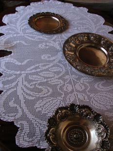 Tablecloth and silver metal platters