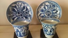 Two tea cups with matching saucers, blue-white decorated with figures and branches - China - 19th century