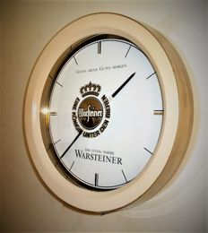 A wall clock of Warsteiner Beer in the form of a beer barrel