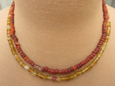 Late medieval necklaces with yellow glass and stone beads - 39 cm and 42 cm. (2)