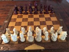 Chinese chess game in wooden foldable storage chest - the pieces are made of alabaster - nicely detailed