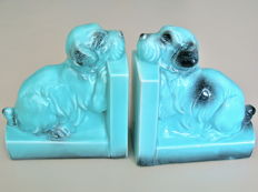 A few fifties blue turquoise glazed earthenware bookends with dogs
