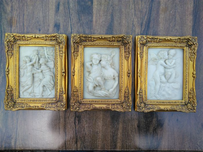 Series of three relief scenes in alabaster in a gold-plated frame