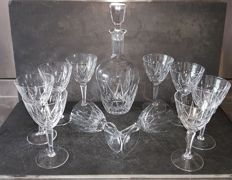 A decanter and 10 glasses in  finely crafted crystal