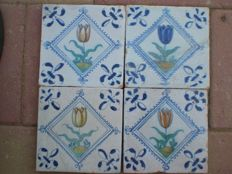 Lot with 4 antique tiles with flowers