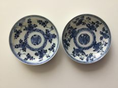 Pair of porcelain saucers with heron - China - 18th century (Kangxi period)