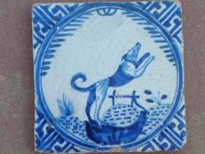 Antique Rotterdam crown tile with dog