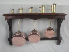 3 Copper pans unused with mounting rack - + 5 brass measuring cups