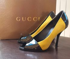 Gucci – Peep Toes with stiletto heels