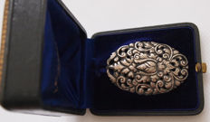 Silver brooch with floral motif