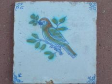 Antique polychrome tile with a bird - parrot (Rare)