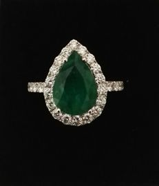 Ring with 3.10 ct emerald and 1.10 ct diamonds (G/VS) 18 kt white gold  Size:  12