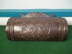 Beautiful old copper or coppered mailbox.