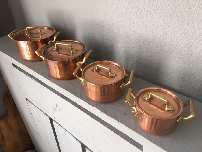 Four copper pans with lid