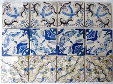 Three quatrefoil tableaux made of Dutch tiles